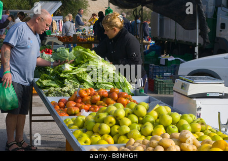 Customer and Stallholder on a Fruit and Vegetable Stall La Marina Spanish Market Spain - Stock Photo