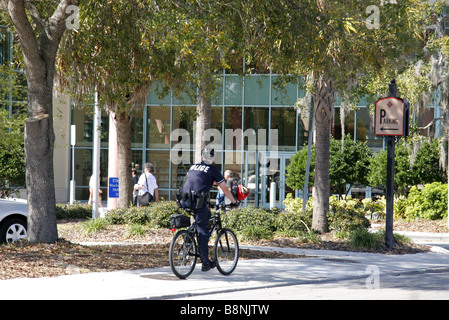 Cop on bicycle in Clearwater Florida USA - Stock Photo