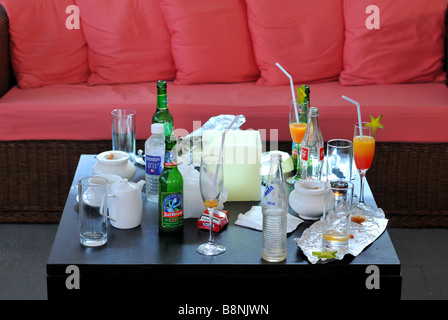 Empty drinks bottles and glasses - Stock Photo