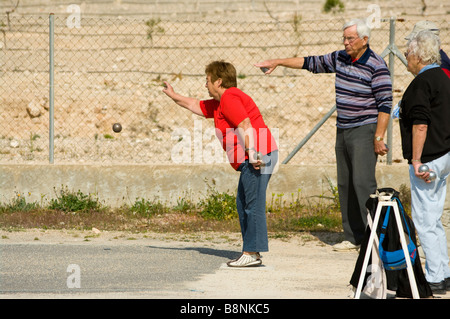 People friends Playing Boules Boulles petanque La Marina Spain - Stock Photo