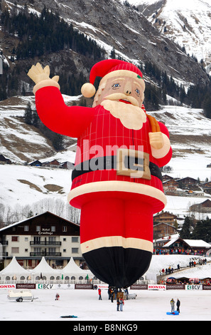 Special shape hot air balloon Colt Santa Claus SS on the launching site, Chateau d Oex, Switzerland - Stock Photo