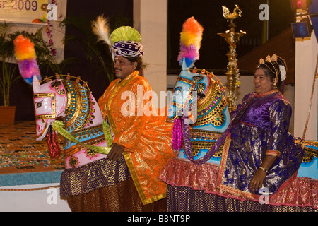 India Tamil Nadu Mamallapuram traditional male and female folk dancers in horse costume - Stock Photo