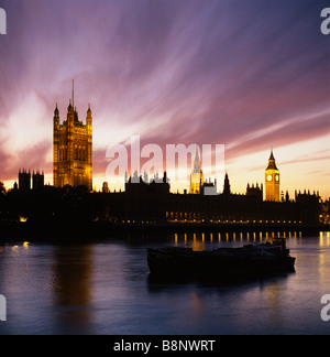 Windswept clouds over the Houses of Parliament at sunset Westminster, London, UK, GB - Stock Photo