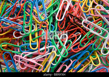 Brightly coloured paper clips - Stock Photo