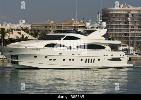 Large Luxury Expensive Motor Cruiser Yacht Boat in Santa Pola Harbour Spain - Stock Photo
