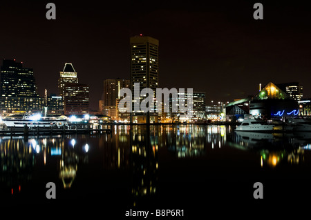 Inner Harbor Reflections in the Chesapeake Bay at night, Baltimore Maryland - Stock Photo