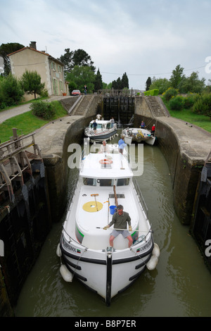 Carcassonne France Barge traverses the Ecluse de Fresquel just outside of Carcassonne on the Canal du Midi - Stock Photo