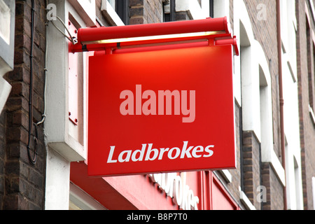 A sign above the Ladbrokes betting shop on Long Lane, London. Feb 2009 - Stock Photo