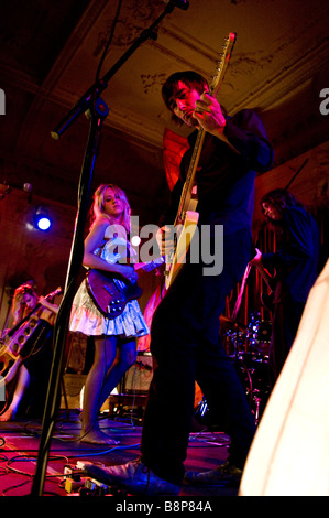 Singer/songwriter Tallulah Rendall performs on stage with her band in London - Stock Photo