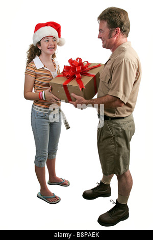 a girl in a Santa hat receiving a gift from a deliver man Full view isolated - Stock Photo