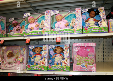 various dolls for sale in a toy store, multi ethnic, variety skin color - Stock Photo