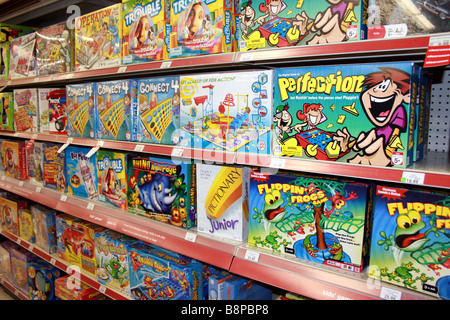 board games on shelf in toy store, united states - Stock Photo