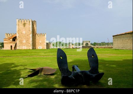 Anchor and Propeller in the Fort Ozama's courtyard - Stock Photo