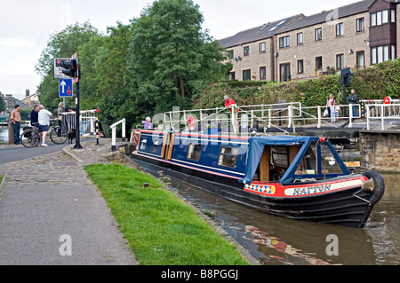Longboat passing Brewery swing bridge near Skipton on the Leeds to Liverpool canal - Stock Photo