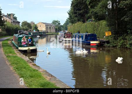 Longboats moored near brewery swing bridge Skipton UK - Stock Photo