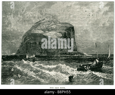 the bass rock sea fishing boat sailors water sail net The Bass Rock, or simply The Bass, is an island in the outer - Stock Photo