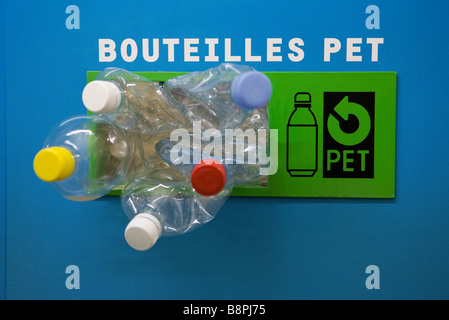Plastic bottles spilling out of recycling bin - Stock Photo