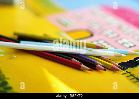 Colored pencils on colorful drawing, close-up Stock Photo