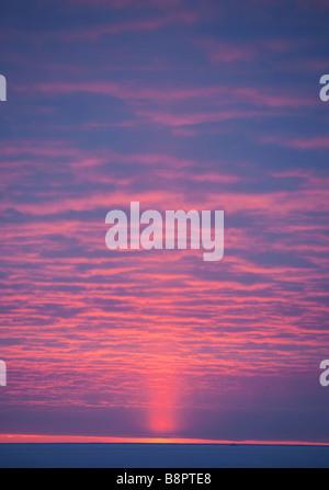Last beam of light at sunset - Stock Photo