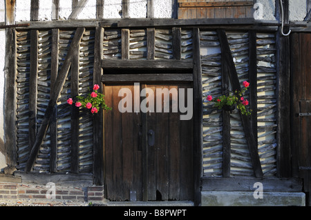 Exposed wall timber frames of an old French farmhouse - Stock Photo