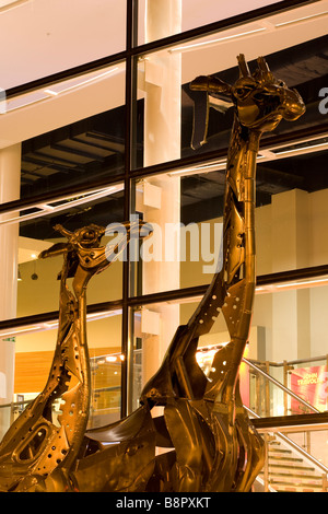 Scotland Edinburgh Omni Centre These two giraffes that stand proud outside the Omni - Stock Photo