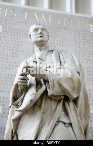 Sir Isaac Newton marble statue in the ante chapel at Trinity College - Stock Photo