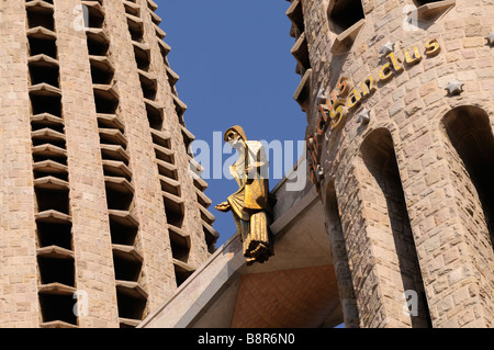 Sculpture of the risen Christ above the Passion facade (by Josep Maria Subirachs). Sagrada Familia. Barcelona. Catalonia. - Stock Photo