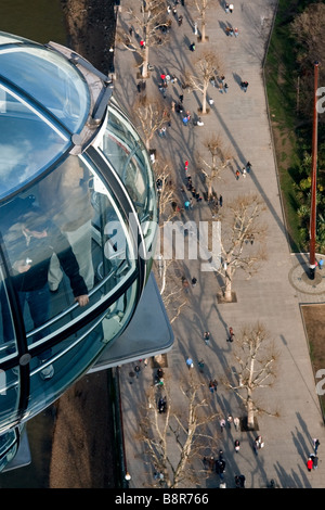 View down from London Eye to the pedestrians on the pavement below - Stock Photo