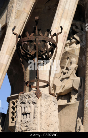 Metallic lantern and Passion facade (by Josep Maria Subirachs). Sagrada Familia. Barcelona. Catalonia. Spain - Stock Photo