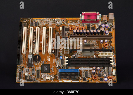 Large printed circuit motherboard on black background. - Stock Photo