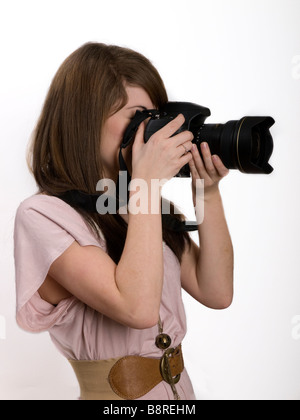 girl with SLR camera - Stock Photo