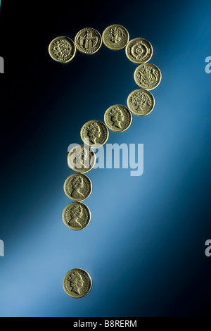 Sterling pound coins in figure of question mark UK - Stock Photo