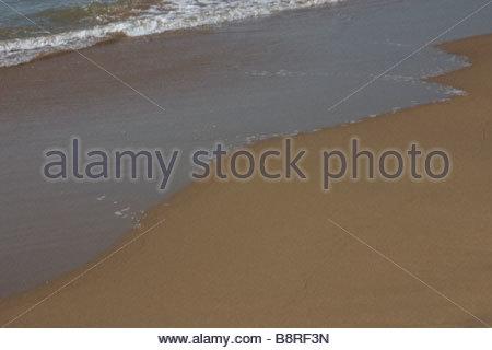 Waves washing onto shore of Gokarna Beach - Stock Photo