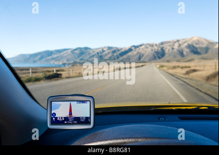 GPS Satellite Navigation in a car on Pacific Coast Highway (Cabrillo Highway) south of the Santa Lucia Mountains, - Stock Photo