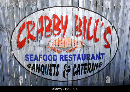 Painted fence panel sign for Crabby Bills restaurant Clearwater Beach Florida USA - Stock Photo