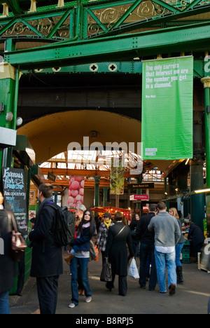 People shopping at Borough Market in London, England UK - Stock Photo