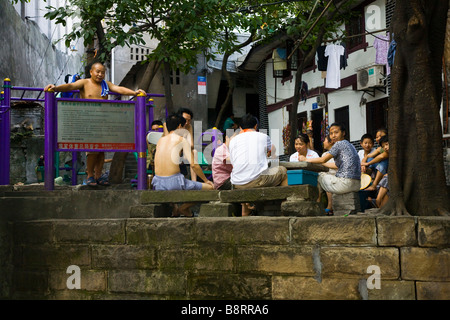 Community gathering in the old part of Chongqing City, southwestern China's boomtown. - Stock Photo