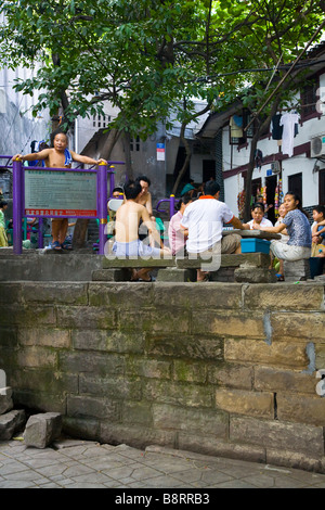 Playing mahjong in the old chinese city in Chongqing, southwestern China. - Stock Photo