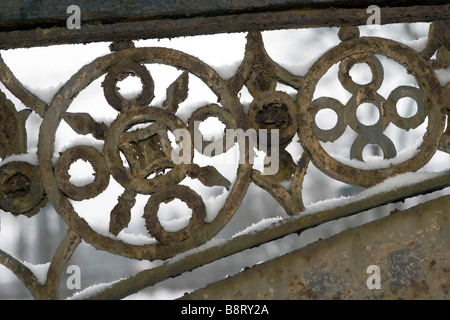 Old metal bridge span forged asian ornaments details in snow. - Stock Photo