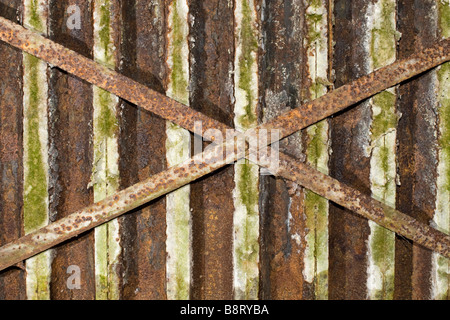 Closeup of small old rusted metal shapes with two big ones intersected. - Stock Photo