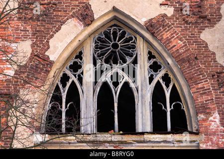 Broken gothic window of old damaged castle. - Stock Photo