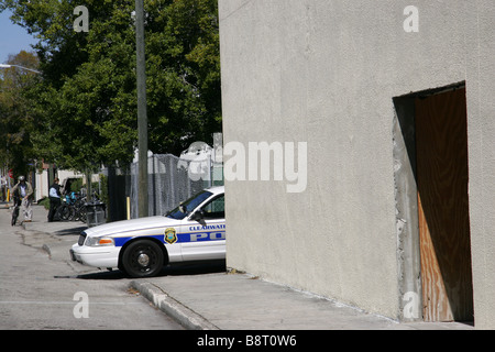 Clearwater police car waiting in an alley in downtown Clearwater Florida USA - Stock Photo