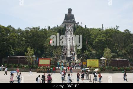 tourists and steps leading Giant Buddha Po Lin Monastery Lantau Island Hong Kong  April 2008 - Stock Photo