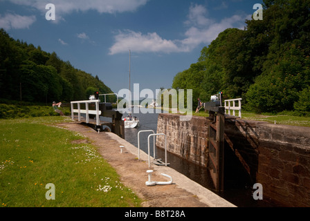 A lock gate being closed on the Crinan Canal, West of Scotland, in the U.K. - Stock Photo
