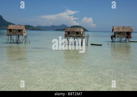 Bajau Laut houses built on stilts in lagoon Pulau Maiga Semporna Sulu Sea Malaysia South east Asia - Stock Photo