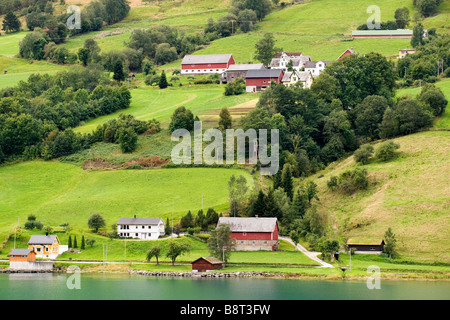 View of hills and farms near Olden, Norway - Stock Photo