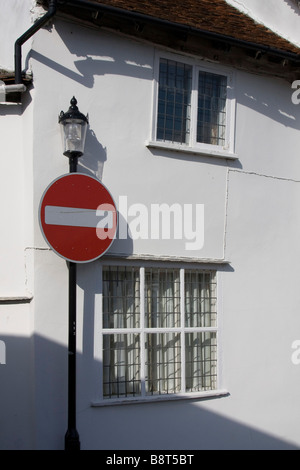 red no entry sign post lavenham pretty historic picturesque village suffolk east anglia england uk gb - Stock Photo