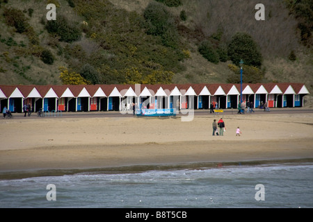 View of Bournemouth beach huts from pier - Stock Photo