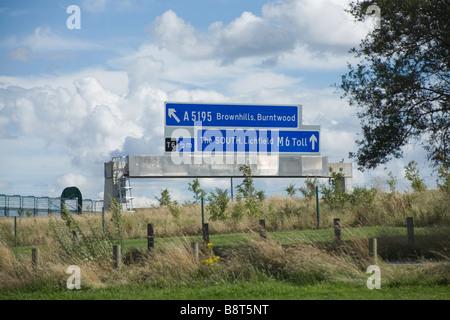 Gantry sign on Midland Expressway England s first toll motorway - Stock Photo