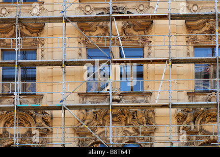 Photo of an old building during the moment of restoration of a facade - Stock Photo